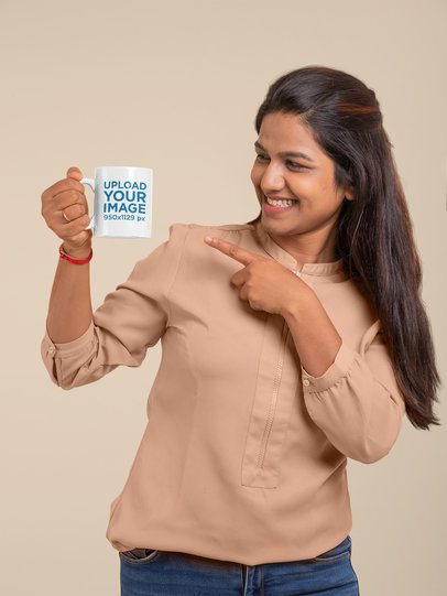 Mockup of a Woman Pointing at an 11 oz Coffee Mug 29081