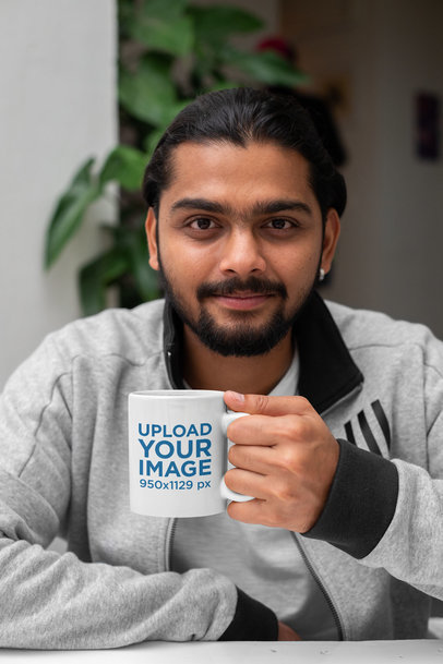 11 Oz Coffee Mug Mockup of a Man with a Plant in the Background 29110