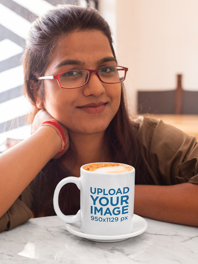 Mockup of a Woman Drinking a Cappuccino in Her 11 Oz Coffee Mug at a Restaurant 29086