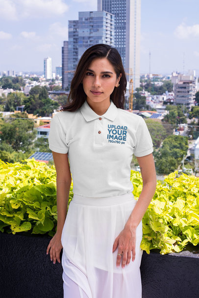 Polo Shirt Mockup of a Stylish Woman Standing in a Balcony With Flowers 28897