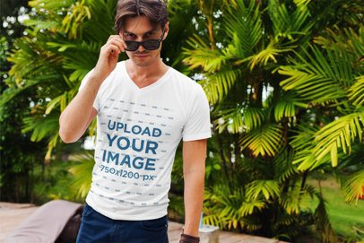 V-Neck T-Shirt Mockup Featuring a Man with Sunglasses Posing Against Some Palm Trees 515-el