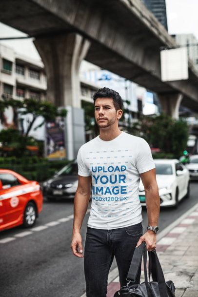T-Shirt Mockup of a Trendy Man Walking Down a Busy Street 441-el