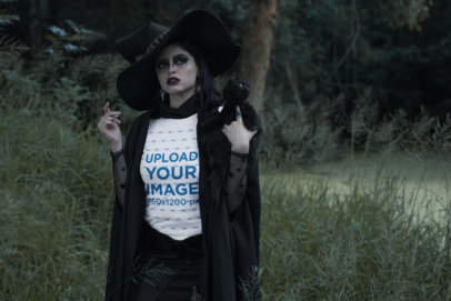 T-Shirt Mockup of a Woman Wearing a Witch Outfit in the Woods 29330