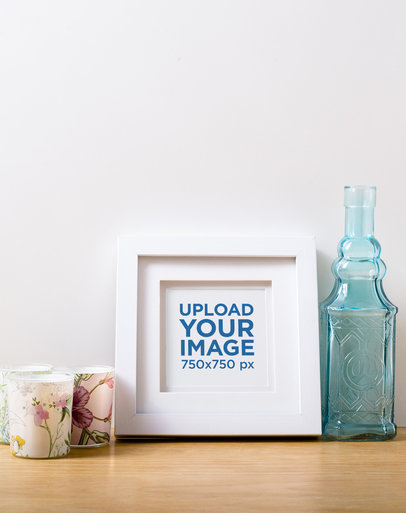 Photo Frame Mockup Featuring Some Candles and a Glass Bottle 591-el