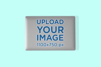 Sticker Mockup Featuring a Macbook Pro on a Color-Custom Surface 673-el