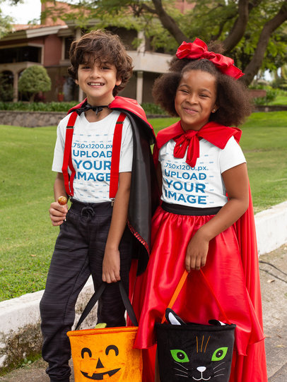 T-Shirt Mockup of a Two Kids Dressed in Halloween Costumes