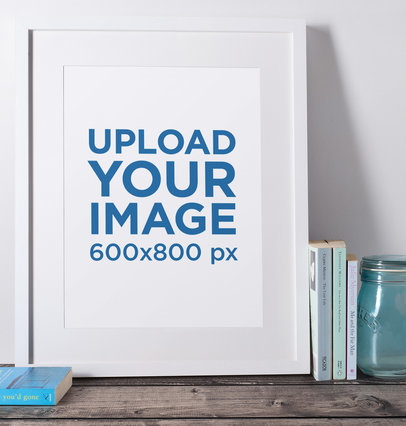 Mockup of a Picture Frame Placed over a Wooden Surface by Some Books 598-el