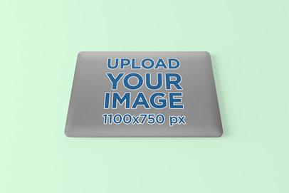 Sticker Mockup over a MacBook Pro in a Minimalistic Setting 674-el