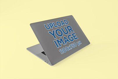 Sticker Mockup of a MacBook Pro with a Customizable Backdrop 675-el