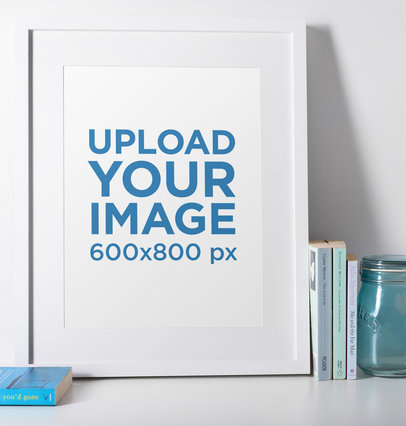 Photo Frame Mockup Featuring a Blue Glass Jar and Some Books 602-el