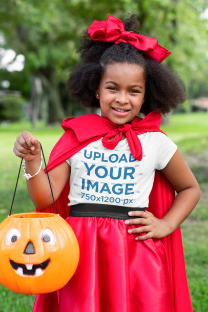 T-Shirt Mockup of a Girl with a Halloween Costume Posing at a Park 29292