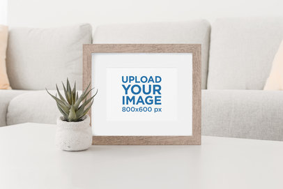 Mockup of a Wooden Picture Frame at a Neat Living Room 623-el