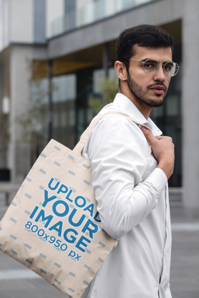 Tote Bag Mockup Featuring a Stylish Man in an Urban Scenario 29427
