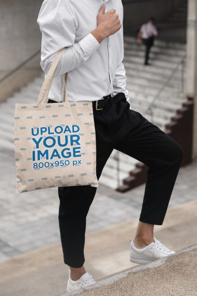 Tote Bag Mockup Featuring a Young Man in a Casual Chic Outfit 29428