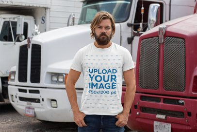 T-Shirt Mockup Featuring a Bearded Man in Front of Trailer Trucks 29480