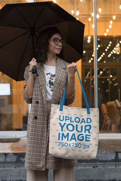 Mockup Featuring a Trendy Woman with a Customizable Strap Tote Bag on a Rainy Day 29420