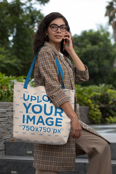 Tote Bag Mockup of a Woman Talking on the Phone in the City