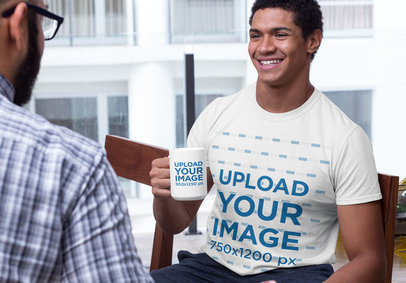 Mockup of a Smiling Man Wearing a Crewneck Tee and Holding a 15 oz Coffee Mug 29258