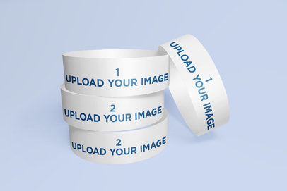 Mockup of a Set of Event Wristbands with a Customizable Background