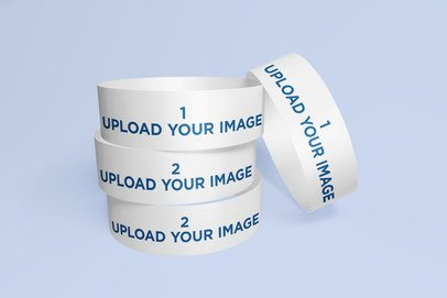 Mockup of a Set of Event Wristbands with a Customizable Background 634-el