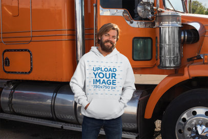 Mockup of a Man Wearing a Pullover Hoodie in Front of a Truck 29492