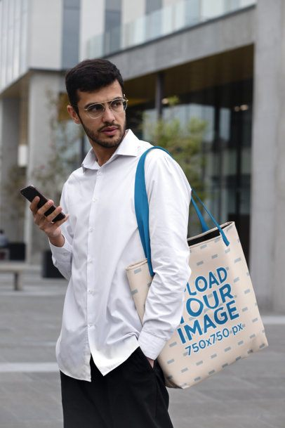 Mockup of a Casual-Dressed Man Carrying a Sublimated Tote Bag  29417