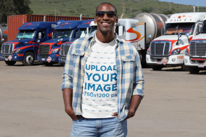 T-Shirt Mockup of a Man with Sunglasses Posing Near Some Trucks 29459