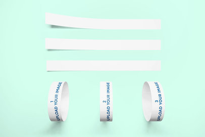 Mockup of Three Event Wristbands Against a Minimalist Surface 638-el