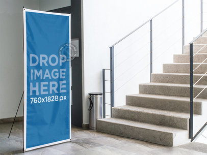 Vertical Banner Mockup Standing Next to a Stairway a10391