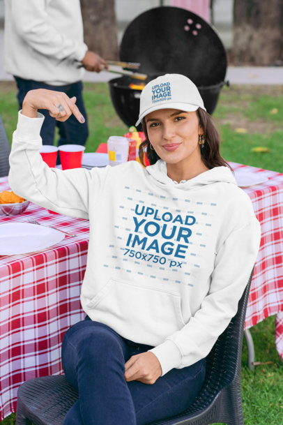 Hoodie Mockup of a Woman with a Dad Hat a BBQ Party 29707