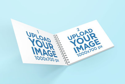 Mockup Featuring an Opened Spiral Notebook Against a Plain Backdrop 462-el