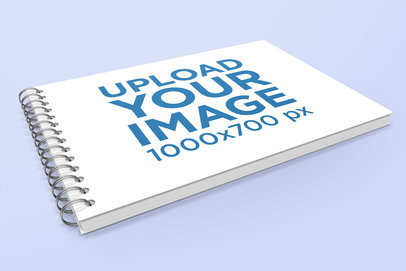 Mockup of a Spiral Notebook Lying on a Plain Color Surface 463-el