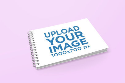 Mockup of a Closed Spiral Notebook Lying on a Solid Color Surface 464-el