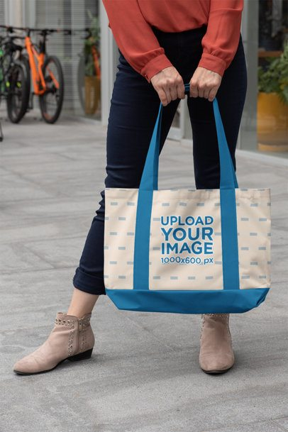 Mockup of a Woman Holding a Weekend Bag with Customizable Strap in the Street 29791