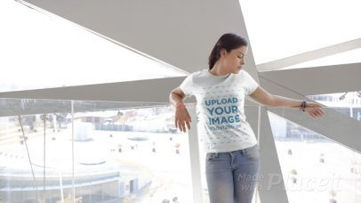 T-Shirt Video of a Smiling Woman in Front of a Glass Wall 12984