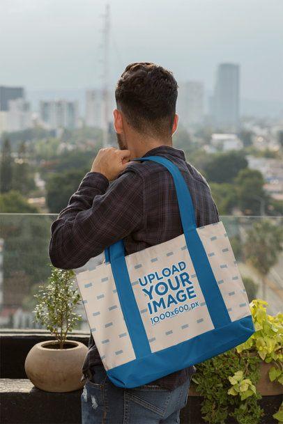 Weekend Bag Mockup of a Man in a Terrace 29796