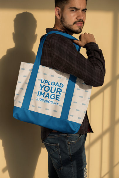Mockup of a Man Holding a Weekend Bag 29797