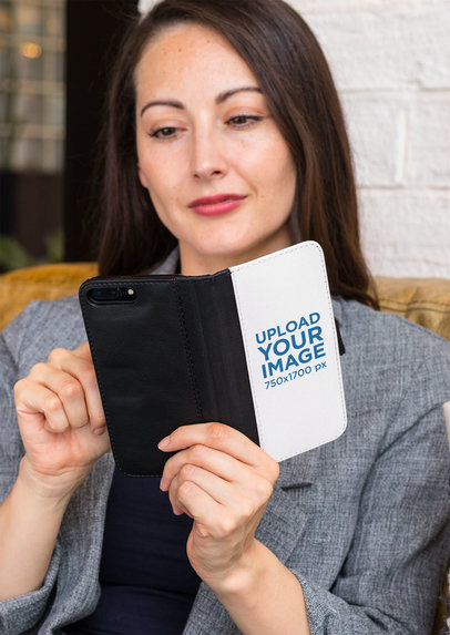 Wallet Case Mockup of a Woman Checking Her iPhone 8 Plus 29806