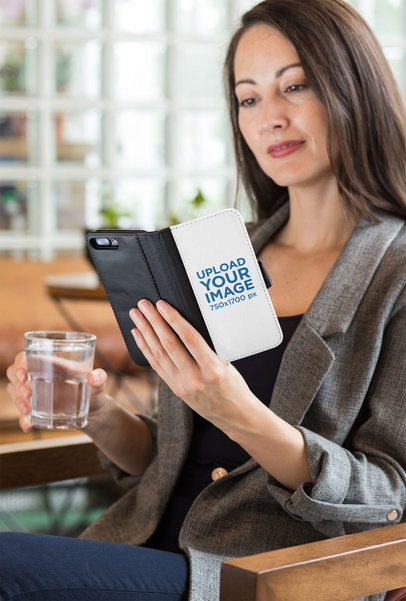 Wallet Case Mockup of a Woman at a Restaurant Looking into Her iPhone 8 Plus 29803
