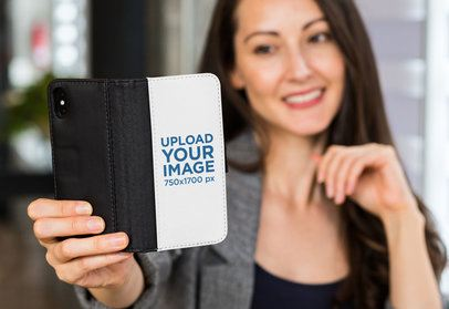Wallet Case Mockup of a Woman Taking a Selfie with Her iPhone X 29809