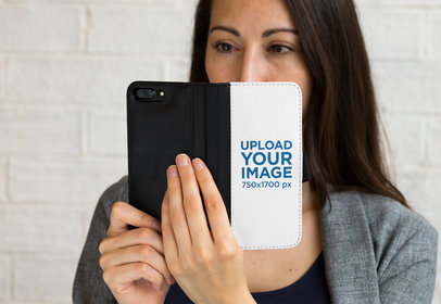 Mockup of a Woman Holding a Wallet Case for iPhone 7 Plus 29805