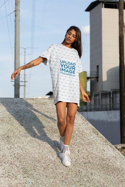 Mockup of a Woman in a Shift Dress Walking on a Concrete Ramp 29732