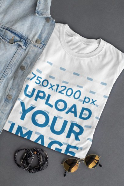 Mockup of a Folded T-Shirt Placed Next to Some Sunglasses 29781