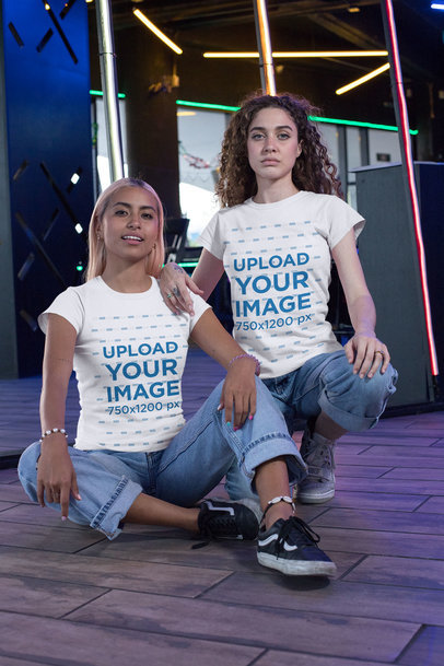 Mockup of Two Women Wearing Matching Best Friend T-Shirts at an Arcade 29632