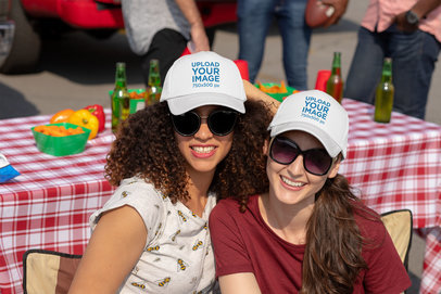 Trucker Hat Mockup Featuring Two Women at a Tailgate Party 29875