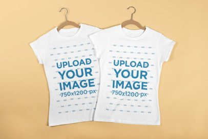 Mockup of Best Friends T-Shirts with Hangers Laying Flat on a Surface 29639