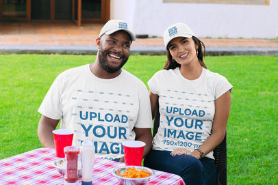 T-Shirt Mockup Featuring a Couple with Customizable Dad Hats 29701