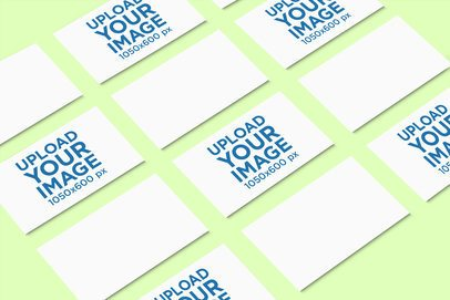 Mockup Featuring Several Business Cards Aligned over a Solid Color Surface 755-el