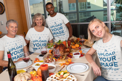 Mockup of a Family Wearing Customizable T-Shirts at a Thanksgiving Dinner