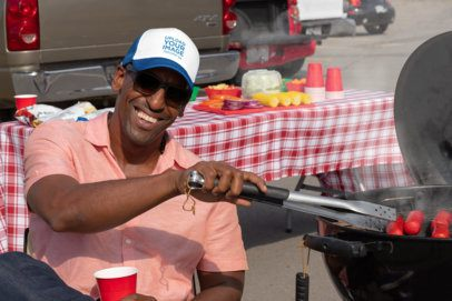 Trucker Hat Mockup of a Man Barbecuing at a Tailgate Party 29878